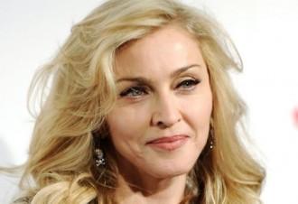 Madonna es despulla per demanar el vot per Clinton